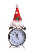 Festive time. Photograph of an alarm clock wearing a christmas hat Stock Image