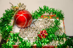 Festive tinsel in a box Royalty Free Stock Image