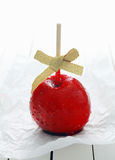 Festive toffee apple with a bow Royalty Free Stock Photo