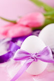 Festive traditional easter egg decoration ribbon and tulips Royalty Free Stock Photography