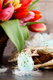 Festive traditional easter egg decoration ribbon and tulips Stock Photo