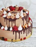Festive two-tier cake with fruit streaks of chocolate Royalty Free Stock Photography