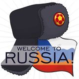 Festive Ushanka and Russia Flag for International Soccer Championship, Vector Illustration. Festive ushanka hat decorated with button with soccer ball silhouette Royalty Free Stock Photography