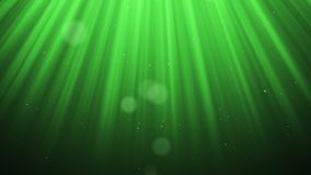 Festive volume light rays with glitter particles bokeh looped animated abstract cg motion green background. stock video