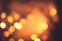 Festive warm bokeh with sparkling Christmas lights in orange colors as Christmas background Stock Images