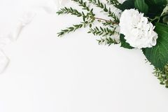 Festive wedding, birthday composition with eucalyptus parvifolia branches, hydrangea flowers and silk ribbon. White. Table background. Rustic styled stock photo stock photo