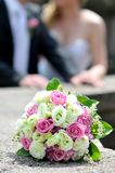 Wedding bouquet with two golden rings Royalty Free Stock Photography