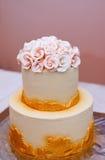 Festive wedding cake with flowers, yellow-orange flowers, bunk, beautiful, gentle royalty free stock images