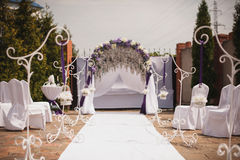 Festive wedding ceremony decoration in white and purple Royalty Free Stock Photography