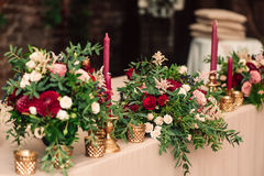 Festive wedding table candle flowers. Festive wedding table setting with flowers, , vintage cutlery,bright table decor details. Candle in a candlestick Stock Photo