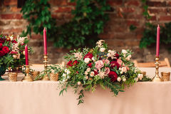 Festive wedding table candle. Festive wedding table setting with flowers, napkins, vintage cutlery, , bright table decor details. Candle in a candlestick Stock Photography