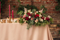 Festive wedding table candle. Festive wedding table setting with , napkins, vintage cutlery, , bright table decor details. Candle in a candlestick Royalty Free Stock Images