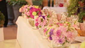 Festive wedding table with flowers stock footage