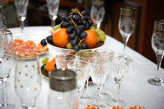 Festive wedding table, glasses of champagne, sandwiches with caviar, snacks, food, pineapples, hearts, love Stock Photo