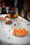 Festive wedding table, glasses of champagne, sandwiches with caviar, snacks, food, pineapples, hearts, love Royalty Free Stock Photos