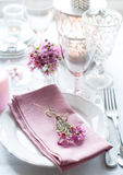 Festive wedding table setting. With pink flowers, napkins, vintage cutlery, glasses and candles, bright summer table decor Royalty Free Stock Photo