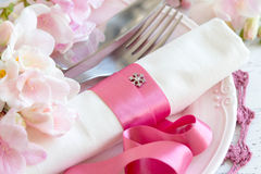 Festive wedding table setting in pink. Festive wedding table setting with pink flowers and ribbon Stock Images