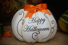 Festive White Halloween Pumpkin. Simplistic Happy Halloween Pumpkin with a festive orange ribbon on top Stock Images
