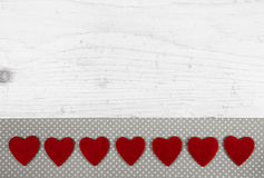 Festive white shabby chic background with red hearts on wood. Royalty Free Stock Photos