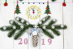 Christmas festive white background with a clock, spruce branches stock photography