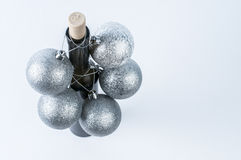 Festive wine. Ice wine bottle with christmas decoration and cork royalty free stock photos