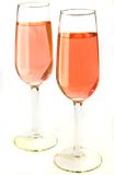 Festive wine. Two stylish glasses with pink wine on a white background Royalty Free Stock Image