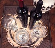 Festive wine and wineglasses. Wine and wineglasses on silver tray ready for a celebration Royalty Free Stock Photos