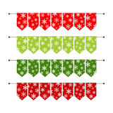 Festive winter bunting flags with snowflakes in traditional colors. For your decoration Stock Photos