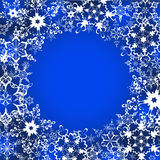Festive winter frame with ornate snowflakes Image stock