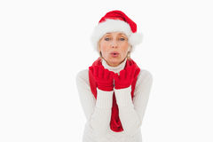 Festive woman blowing a kiss Royalty Free Stock Photo