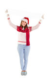 Festive woman holding up empty banner Stock Image