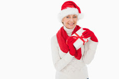 Festive woman smiling at camera holding a gift Stock Image
