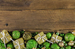 Festive wooden christmas background with golden presents and gre Stock Photos