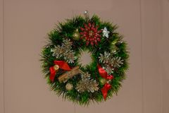 A festive wreath adorned with bows, ribbons, toys Stock Image