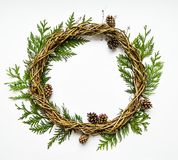 Festive wreath of vines with thuja branches and cones. Flat lay, top view stock image