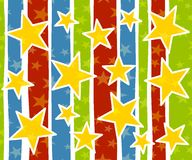 Festive Xmas Stars Background. A background pattern featuring red, blue and green stripes with gold stars Stock Photo