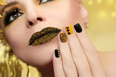 Festive yellow black manicure and makeup . Royalty Free Stock Images