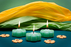 Festive yellow-green background with candles Royalty Free Stock Photos