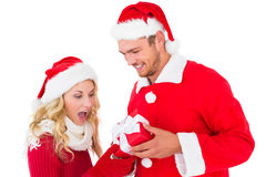 Festive young couple exchanging presents Royalty Free Stock Image
