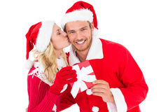 Festive young couple exchanging presents Royalty Free Stock Photo