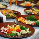 Festively covered table. With various dishes Stock Photo