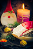 Festively decorated Christmas table tableware candles mood. Festively decorated Christmas table: tableware, candles, all in the Christmas mood Royalty Free Stock Photography