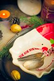Festively decorated Christmas table tableware candles mood. Festively decorated Christmas table: tableware, candles, all in the Christmas mood Royalty Free Stock Photo
