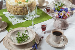 Festively decorated table with served coffee and cake Stock Photo