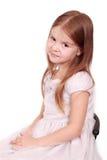 Festively dressed little girl Stock Photos
