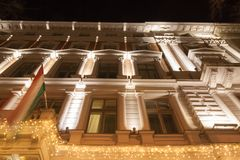 Festively Illuminated Building and Hungarian Flag royalty free stock photography