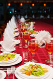 Festively served banquet table with glasses Stock Images