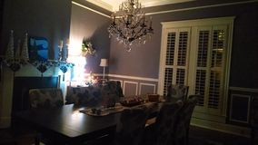 Festivities. Here is a dining room still set for Christmas dinner Stock Image