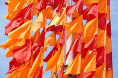 Festliche Flaggen der roten und orange Farbe Stockfotos