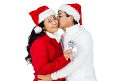 Festliche ältere Paare, die Geschenke austauschen Lizenzfreies Stockbild